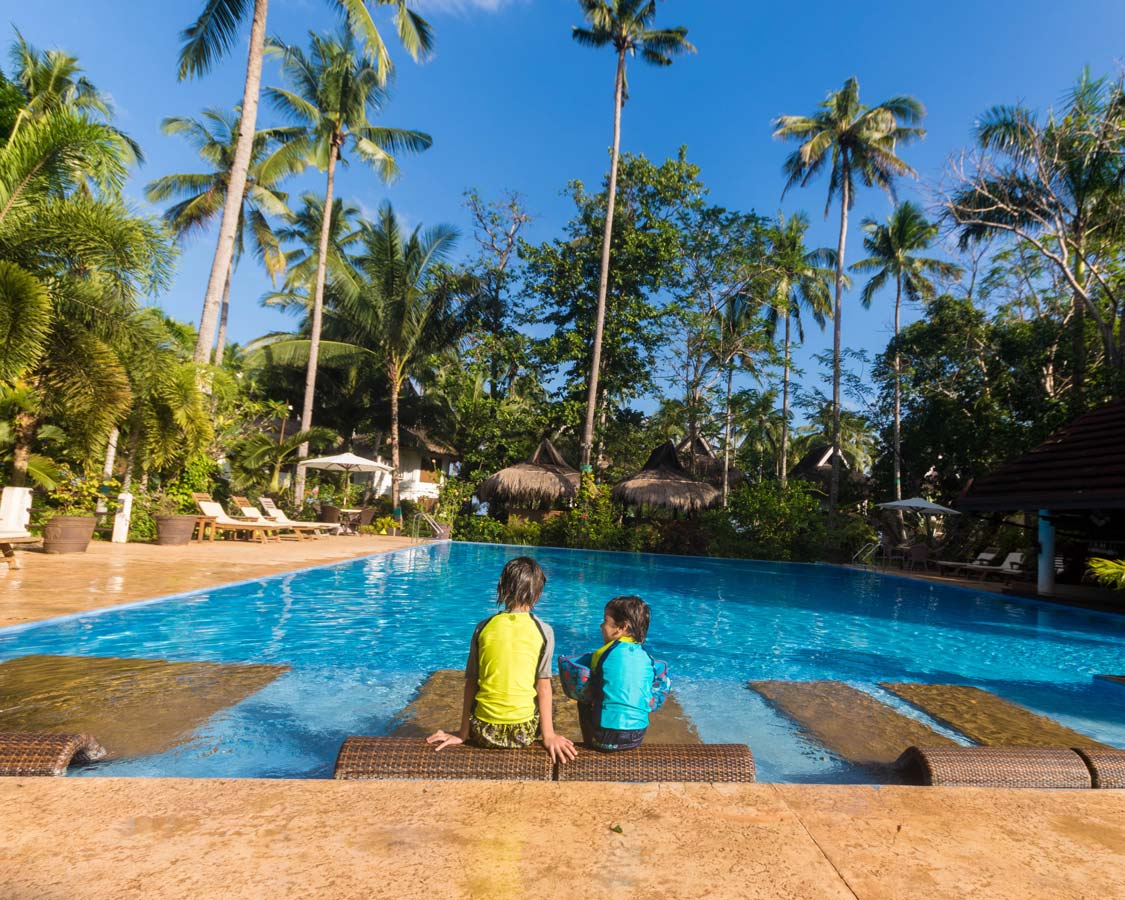 boys by a pool at Daluyon Beach Resort in Sabang Philippines