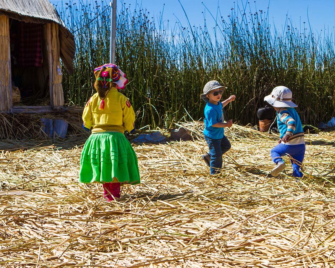 Children playing on Lake Titicaca Isla de los Uros