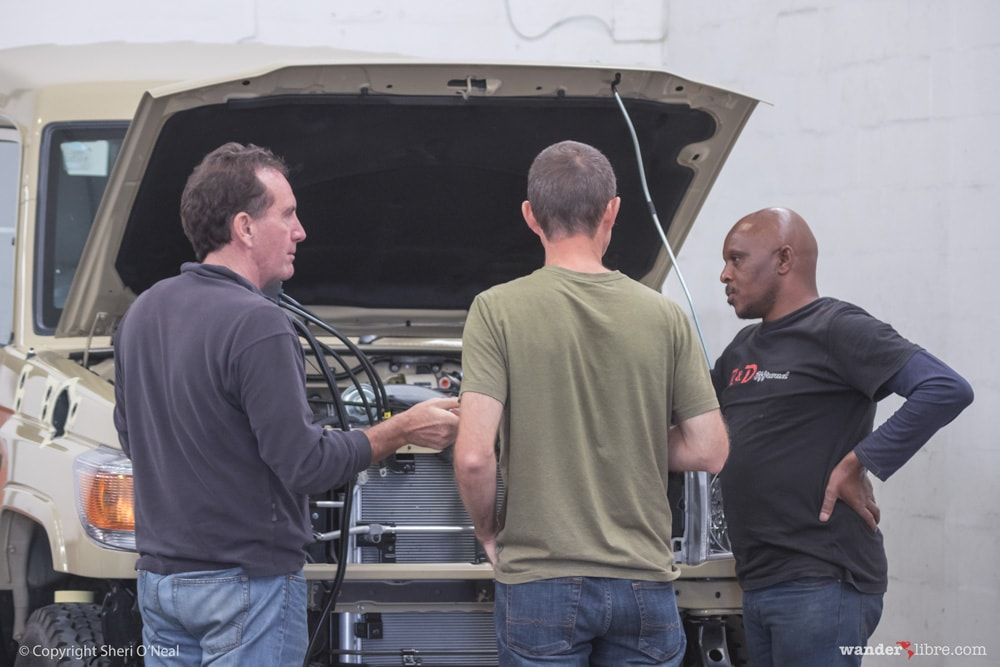 Jim Discusses Air Compressor Placement with the Team