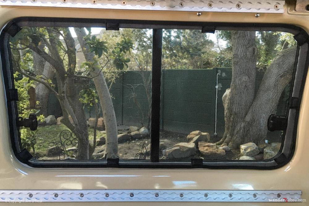 Custom Magnetic Bug Screens Over Rear Windows of Troop Carrier