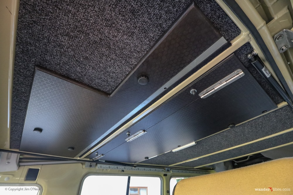 Drop-down Cargo Barrier Between Front and Rear Cabins in Land Cruiser Tiny Home