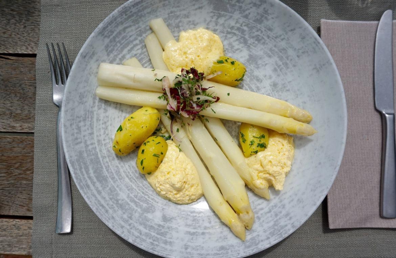Seasonal white asparagus with bernaise at Aiola Upstairs in Graz, Austria