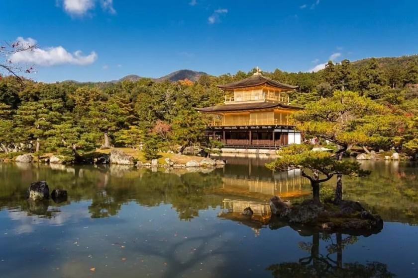 View of Kinkaku-ji temple in Kyoto on a sunny autumn day.