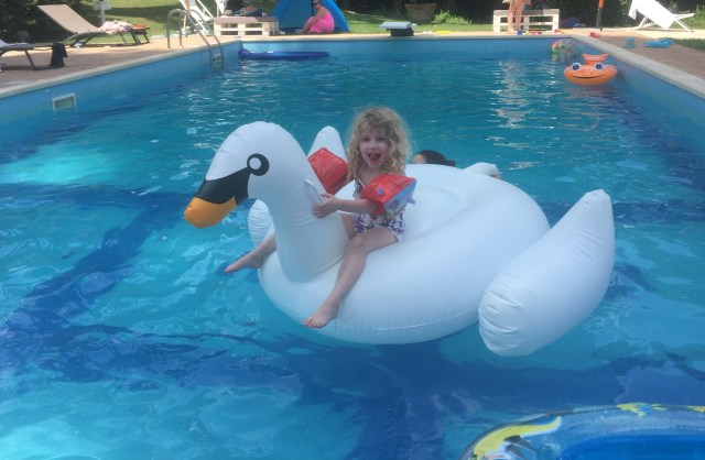 Italy: Mrs T on swan inflatable