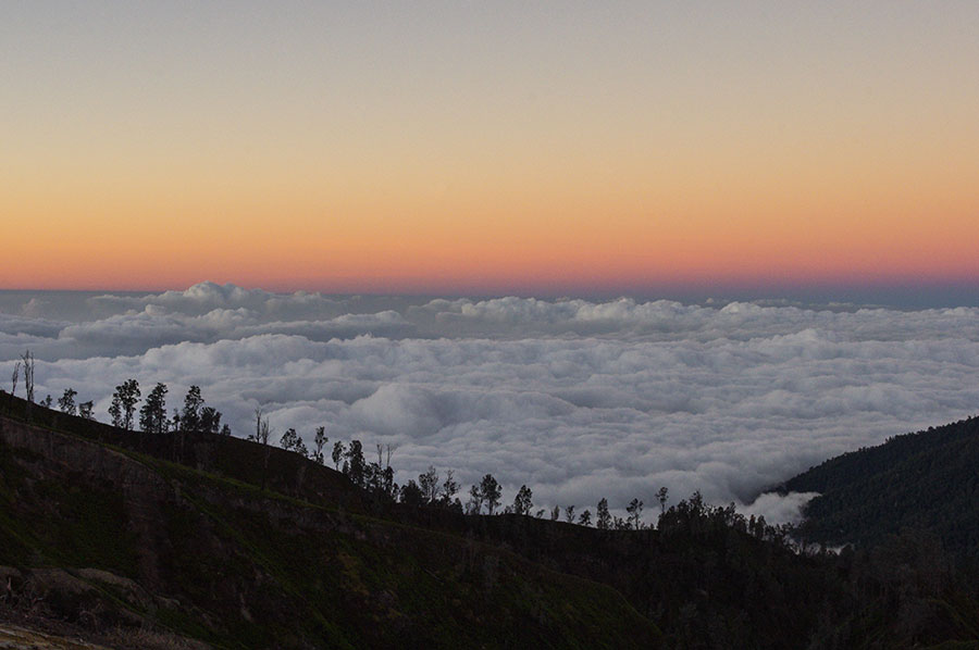 Above the clouds, at the summit of Mount Ijen.