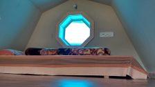 Lovely attic with porthole