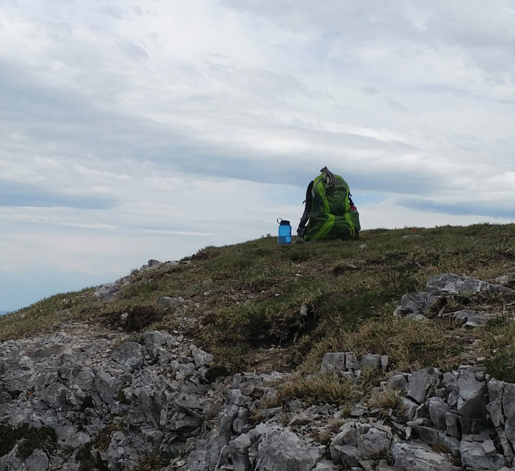 An image of a backpack at the summit of Prairie Mountain in Kananskis, Alberta