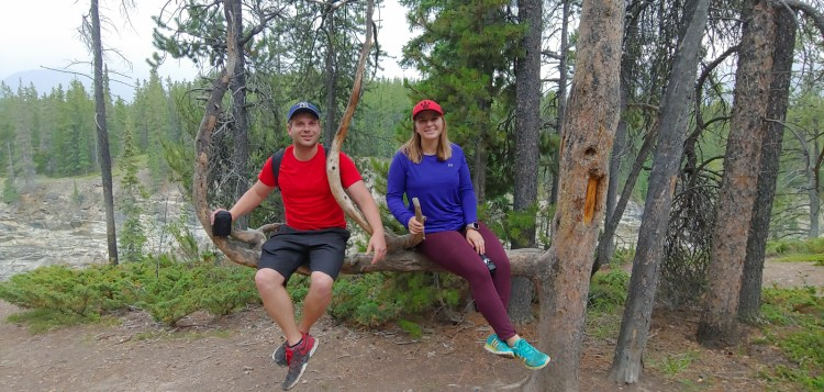 Image of Brady and Carleigh sitting in an interesting tree