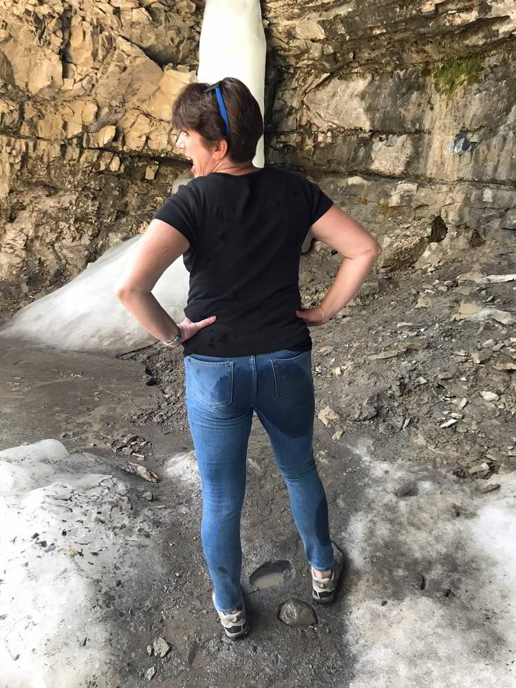 An image of a woman with a large wet spot on the back of her jeans
