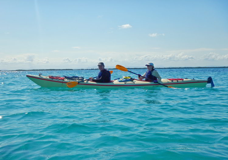 An image of two people kayaking in Belize in South Water Caye Marine Reserve