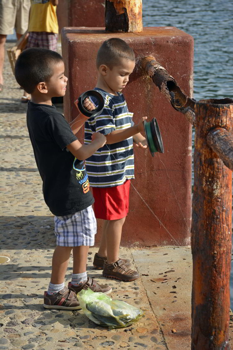 An image of two boys fishing in Yelapa - Jalisco, Mexico - Yelapa Beach