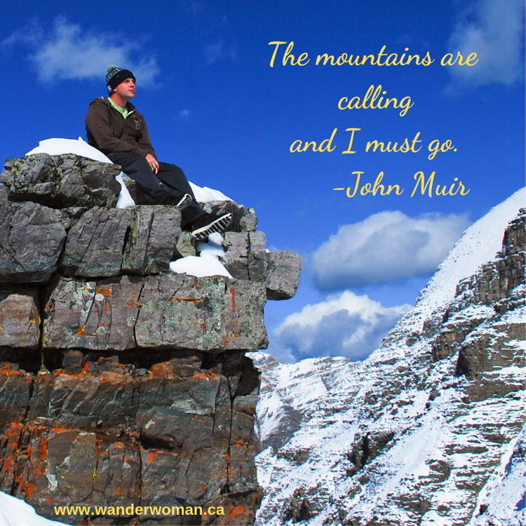 An image of a man sitting on a mountain top at Sentinel Pass in Banff National Park - meaningful quotes about nature - The mountains are calling and I must go - John Muir