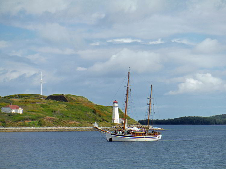 An image of a tall ship sailing past George's Island near Hallfax, Nova Scotia Canada - Halifax tours