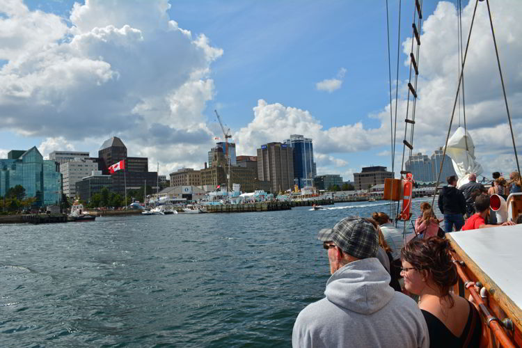 An image of people looking at the view of Halifax harbor from a tall ship sailing tour in Halifax, Nova Scotia Canada - Halifax tours