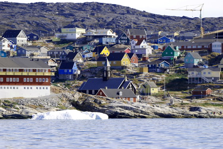 An image of the colorful houses in Ilulissat, Greenland