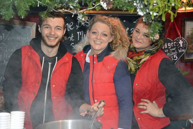 An image of three mulled wine vendors at the Lincoln Christmas market in Lincolnshire, England - best Christmas markets