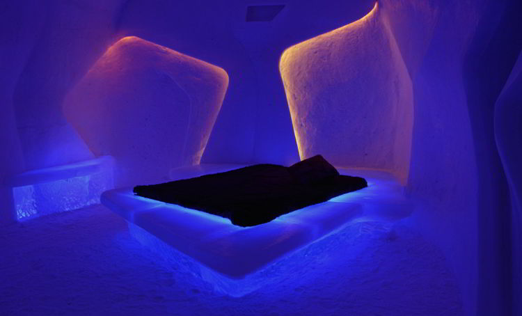 An image of a room with mauve lighting at the Hôtel de Glace in Quebec, Canada - Ice Hotel Quebec