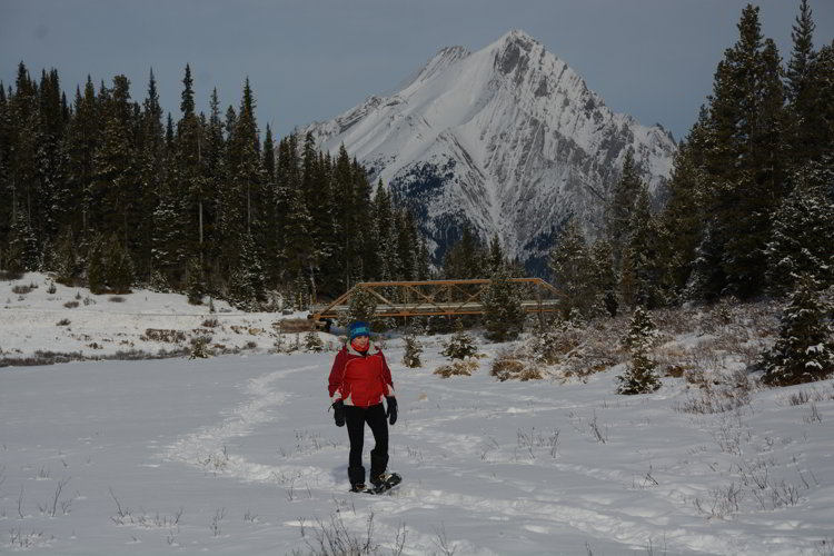 Image of a person hiking in snow shoes in Kananaskis Country - Avoid the Winter Blues.