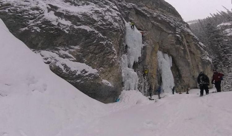 An image of frozen waterfalls and ice climbers on the Grotto Canyon hike near Canmore, Alberta