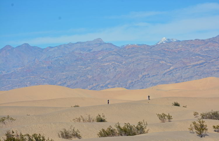An image of two people standing on the Mesquite Flat Sand Dunes in Death Valley National Park in California - visiting Death Valley