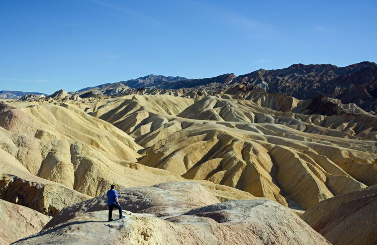An image of a man overlooking Zabriskie Point in Death Valley National Park in California - visiting death valley