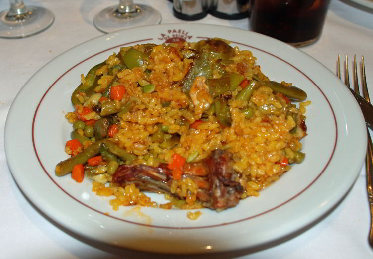 An image of a plate of paella in Spain - Trafalgar Tours Europe