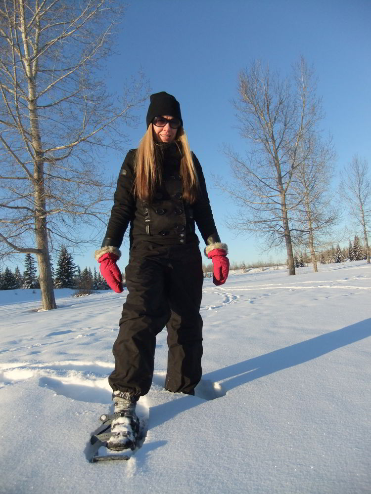 An image of a woman snowshoeing at Gaetz Lakes Sanctuary in Red Deer - things to do in Red Deer in Winter