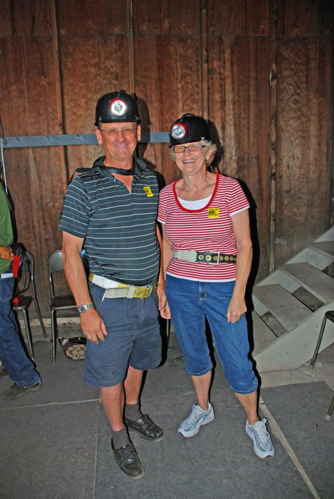 An image of two people geared up for a tour of the Atlas Coal Mine near Drumheller, Alberta