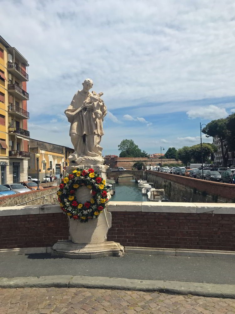An image of a statue in Venezia Nuovo or New Venice in LIvorno, Italy.