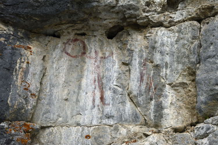 An image of the pictographs on the Grassi Lakes hike near Canmore, Alberta in the Canadian Rockies.