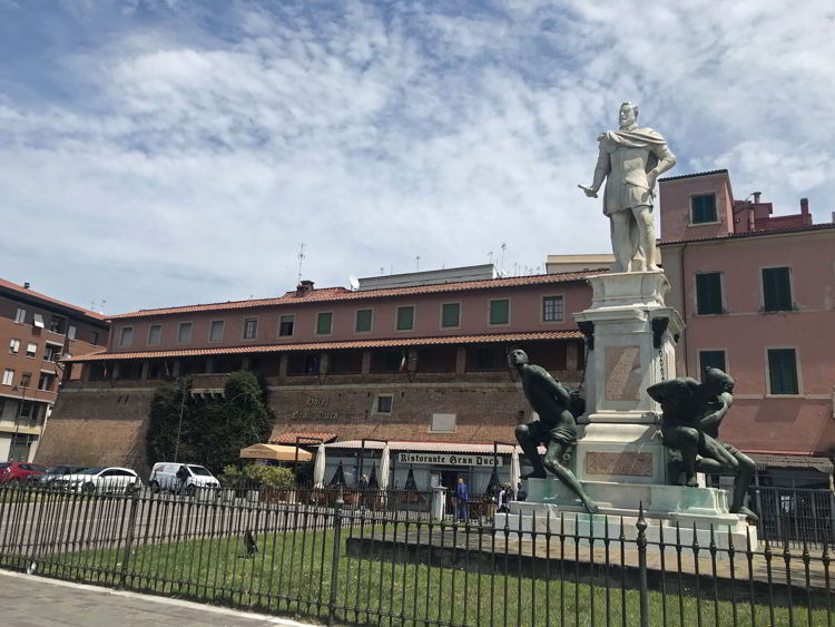 An image of a statue seen along Via Grande in Livorno, Italy - exploring Livorno cruise port.