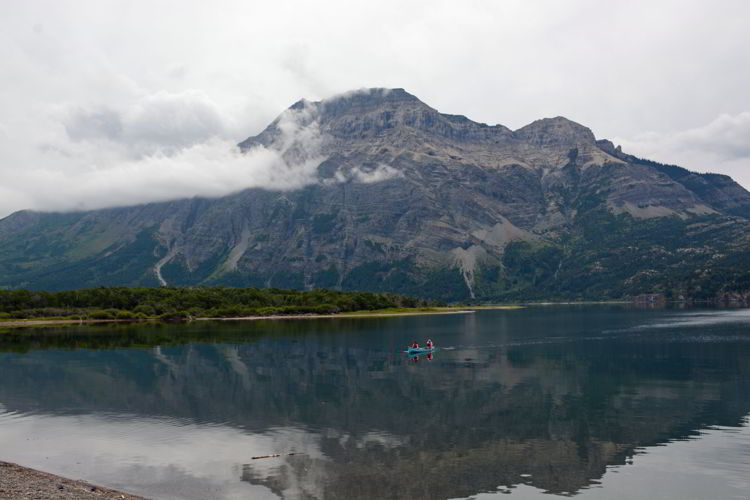 An image of a canoe on Upper Waterton Lake in Waterton Lakes National Park in Alberta, Canada.