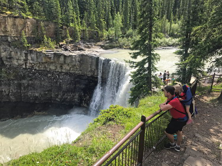 An image of a man with a baby carrier on the Crescent Falls hike in David Thompson Country, Alberta.