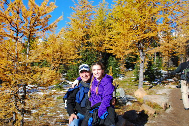 An image of a father and daughter on the Larch Valley hike in Banff national Park, Alberta, Canada.