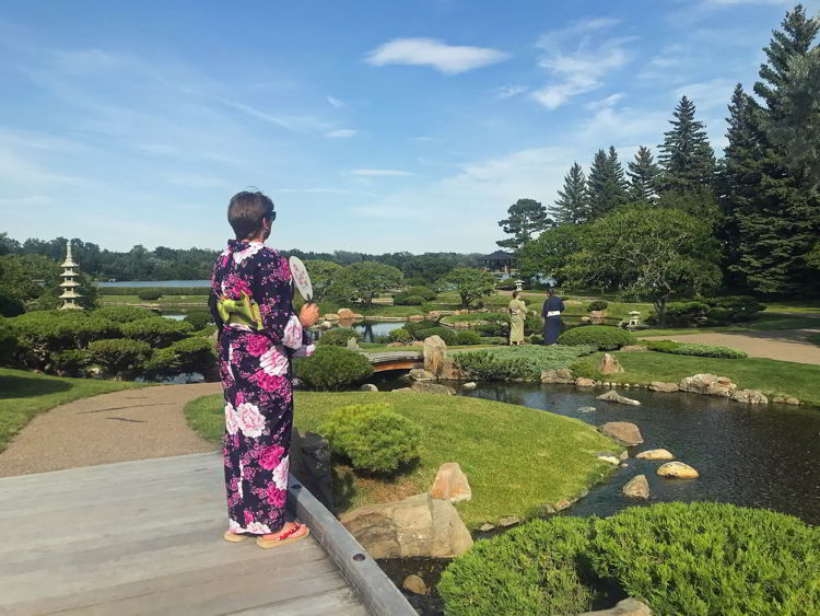 An image of someone in a standing in the Nikka Yuko Japanese Gardens - Things to do in Lethbridge, Alberta.