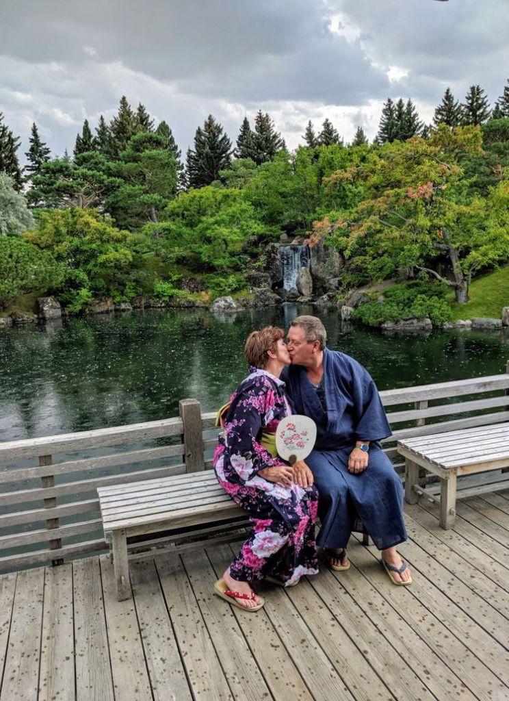 An image of a couple kissing at the Nikka Yuko Japanese Gardens in Lethbridge, Alberta.
