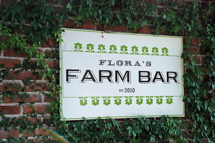 An image of the Flora Farms bar sign in Cabo San Lucas, Mexico.