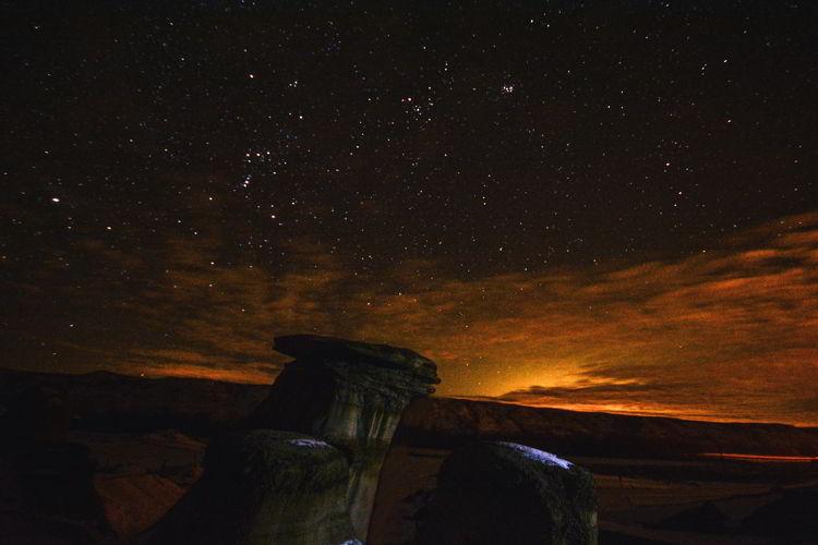 An image of the hoodoos near Drumheller, Alberta at night.