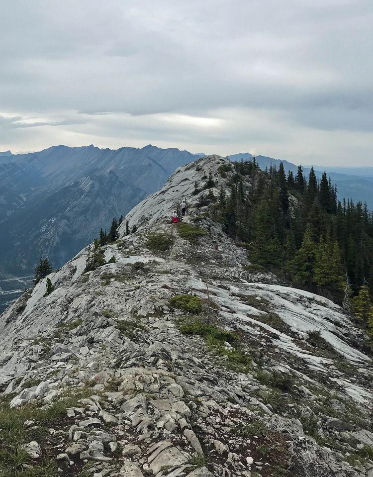An image of the ridge walk between Grant MacEwan peak and the third unnamed peak on the Heart Mountain Horseshoe hike near Canmore, Alberta.