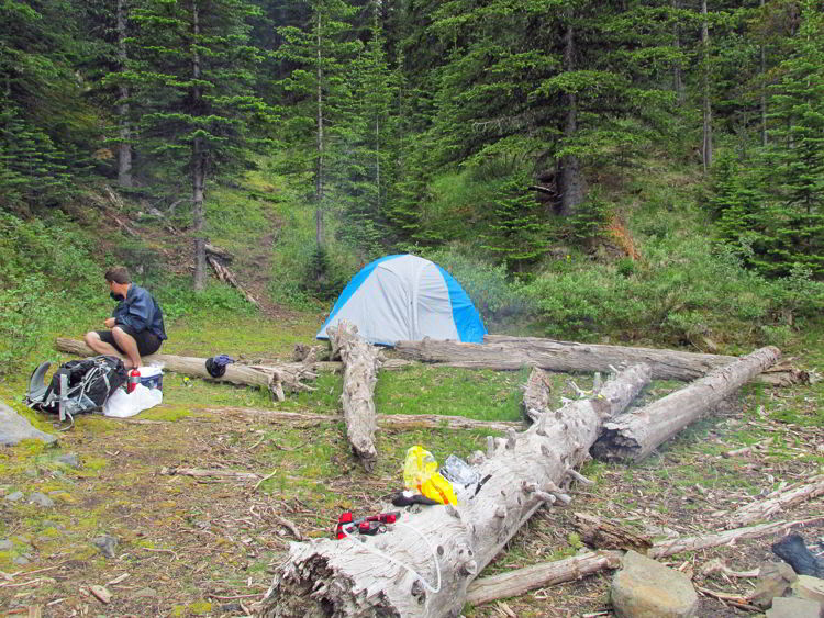 An image of a campsite on the shore of Allstones Lake in Alberta, Canada.