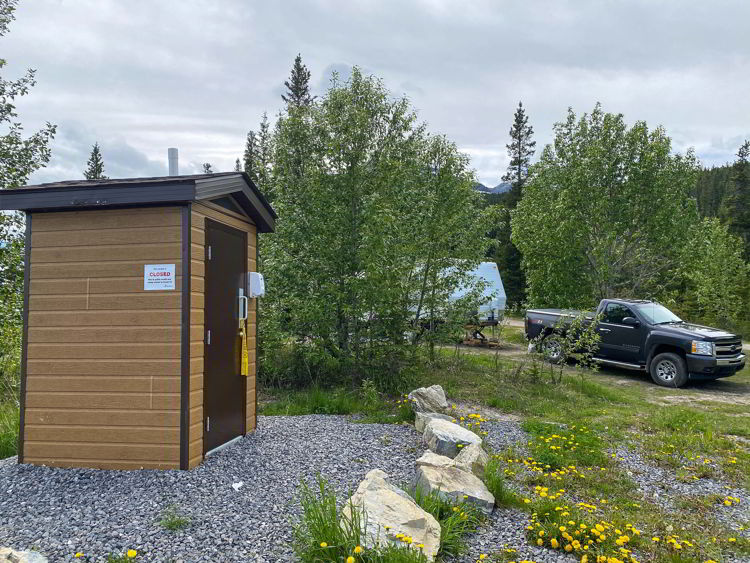 An image of the toilets beside Abraham Lake in Alberta, Canada.