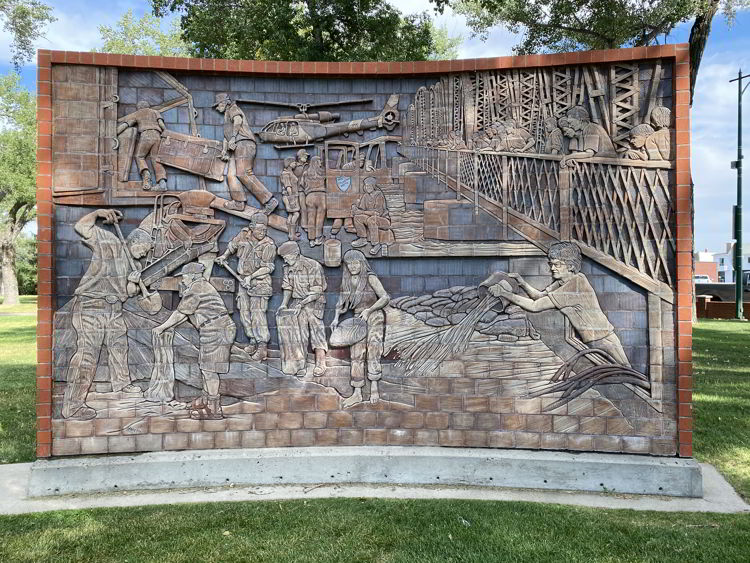 An image of a James Marshall mural in medicine Hat, which commemorates the 1995 flood.