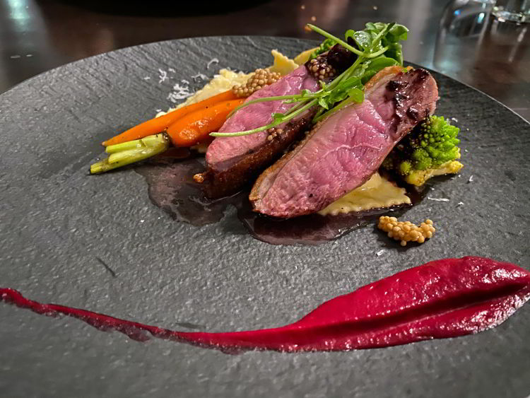 An image of the duck entree at The Sensory Restaurant in Canmore, Alberta, Canada.