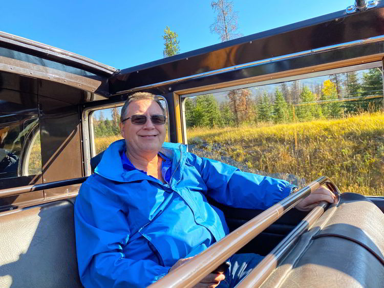An image of a man sitting in the back of the antique jammer bus on a tour with Sundog Tours in Jasper National Park, Alberta, Canada.