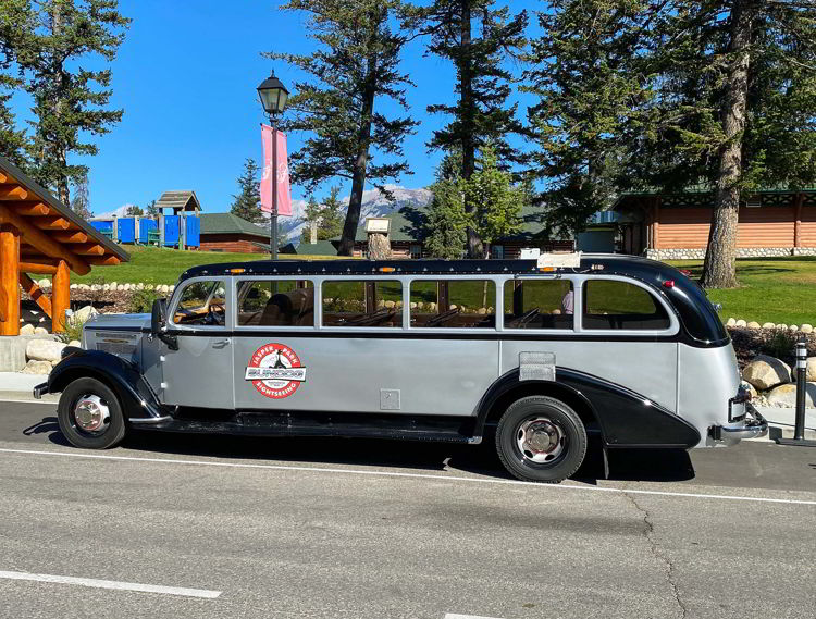 An image of the antique jammer bus owned by SunDog Tours in Jasper National Park, Alberta, Canada.
