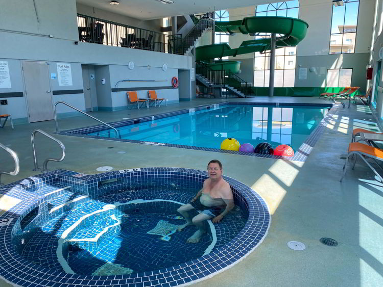 An image of the pool and waterslide at Holiday Inn Hotel & Suites in Medicine Hat, Alberta, Canada.