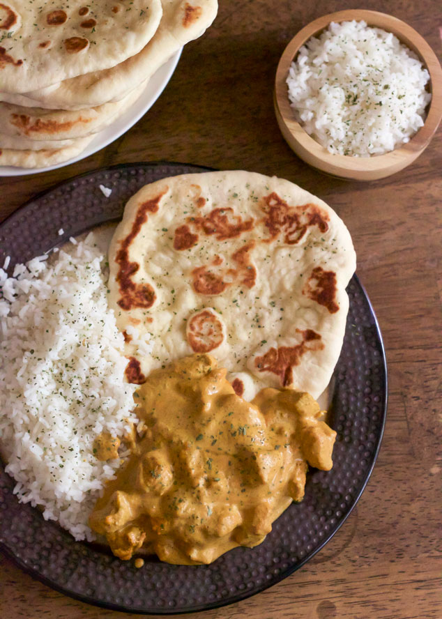 Spicy Butter Chicken with Naan - No need to simmer this curry for hours, this recipe is ready in less than 40 minutes! | wanderzestblog.com