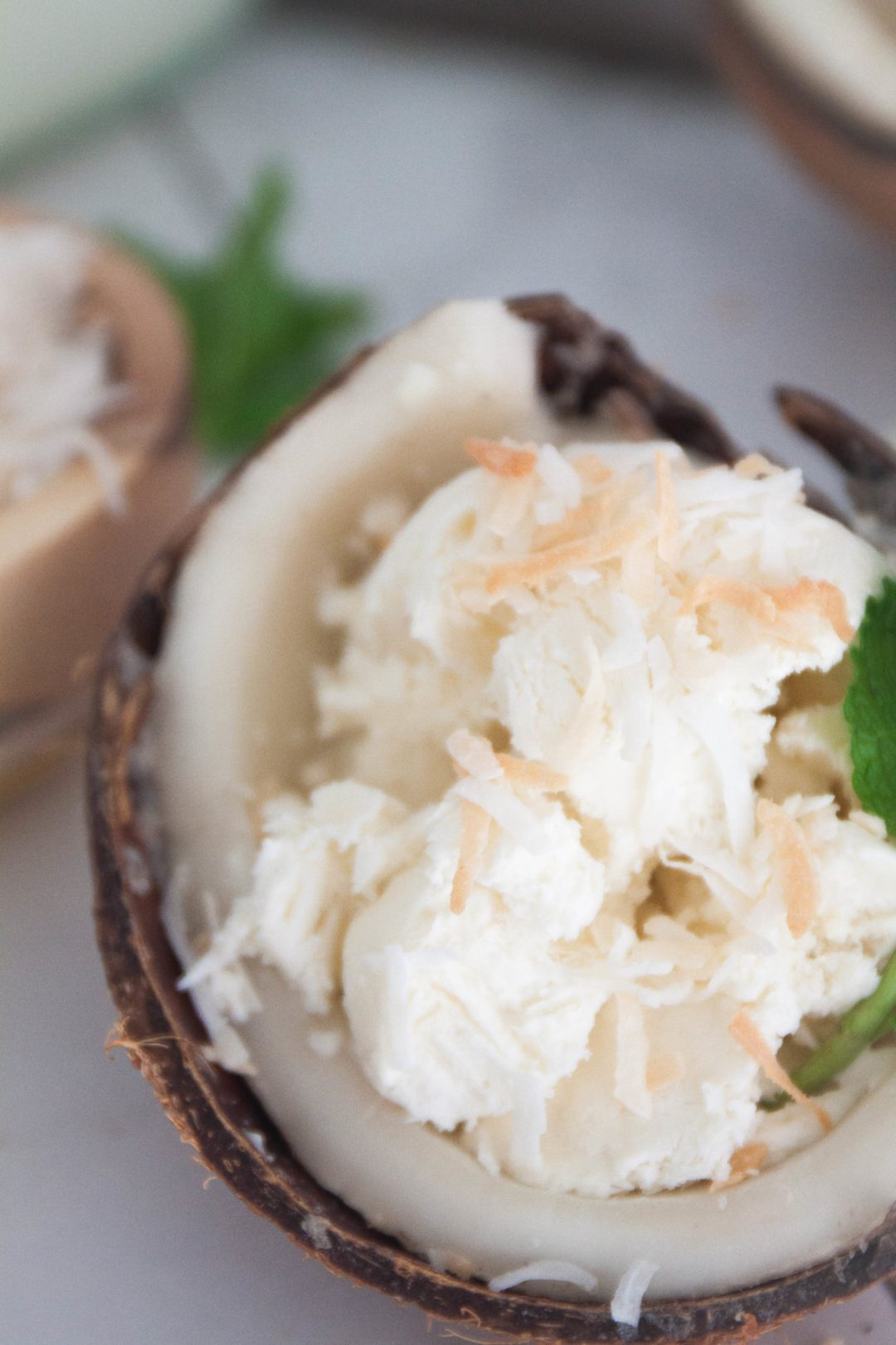 No Churn Creamy Coconut Ice Cream - Sweet, creamy, coconutty. This no churn coconut ice cream is simply delightful and is a cinch to make. And you don't even need to have an ice cream maker! | wanderzestblog.com