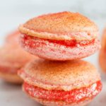 Strawberry Cheesecake Macarons combine the flavors of strawberry cheesecake with the melt in your mouth texture of macarons to create a truly delightful and unique dessert.   wanderzestblog.com #macarons #french #strawberry #cheesecake