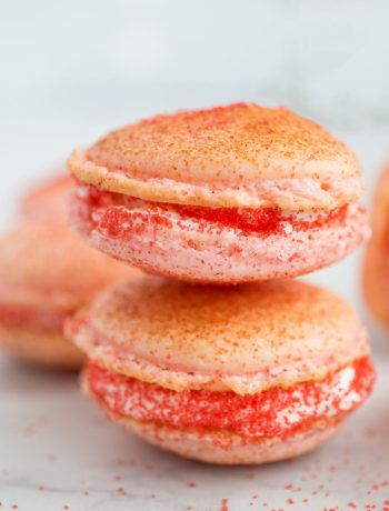 Strawberry Cheesecake Macarons combine the flavors of strawberry cheesecake with the melt in your mouth texture of macarons to create a truly delightful and unique dessert. | wanderzestblog.com #macarons #french #strawberry #cheesecake
